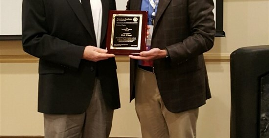 Dr. Bryan Sibley presents Rick Wheat with the Sandra C. Adams Award